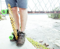Young handsome real hipsrter guy bearded staying under the bridge extreeme with leopard skateboard, lifestyle people Stock Photo