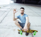 Young handsome real hipsrter guy bearded staying under the bridge extreeme with leopard skateboard, lifestyle people Stock Photography