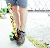Young handsome real hipsrter guy bearded staying under the bridge extreeme with leopard skateboard, lifestyle people Royalty Free Stock Photography