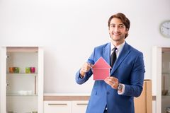 The young handsome realtor selling flat. Young handsome realtor selling flat royalty free stock images