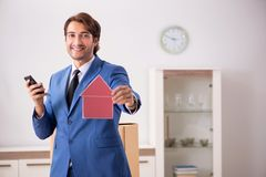 The young handsome realtor selling flat. Young handsome realtor selling flat royalty free stock photos