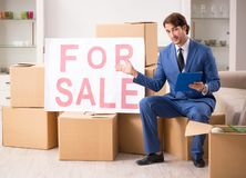 The young handsome realtor selling flat. Young handsome realtor selling flat royalty free stock photo