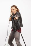 Young handsome rock singer holding microphone Stock Photo