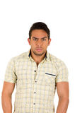 Young handsome serious hispanic man with a frown Stock Images