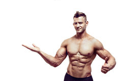 Muscular male posing on white. Young handsome and shirtless male with strong body posing and gesturing  on white Stock Photo