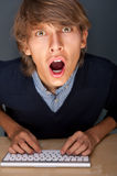 Young handsome shocked good looking man Royalty Free Stock Photo