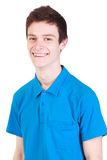 Young handsome smiling man in blue t-shirt isolate. Young handsome smiling man wearing blue t-shirt isolated on white background Royalty Free Stock Photography