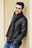Young handsome smiling man wearing fashionable clothing. Outdoor Royalty Free Stock Photography