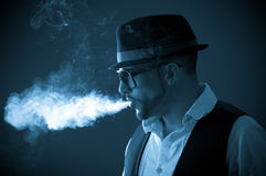 Young handsome stylish male model smoking a Stock Photography