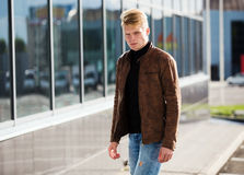 Young handsome stylish man in brown jacket in autumn time outdoor in casual style Stock Images