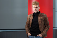 Young handsome stylish man in brown jacket in autumn time outdoor in casual style Stock Photos