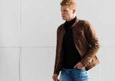 Young handsome stylish man in brown jacket in autumn time outdoor in casual style Stock Photography