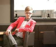 Young handsome stylish man posing indoor Stock Photography