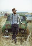 Young handsome stylish man, wearing shirt and bow-tie wih old cars Stock Photography