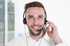 Young handsome technical support dispatcher working. Closeup Royalty Free Stock Photo