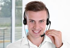 Young handsome technical support dispatcher working, closeup stock images
