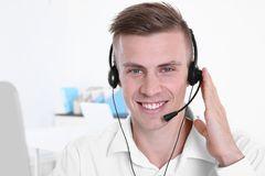 Young handsome technical support dispatcher working, closeup stock image