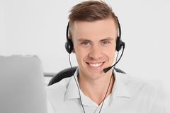 Young handsome technical support dispatcher working. Closeup stock image