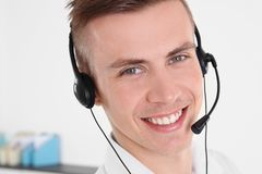 Young handsome technical support dispatcher working. Closeup royalty free stock image