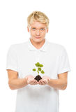Young and handsome teenage boy holding a plant Royalty Free Stock Photos