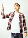 Young handsome teenage hipster guy posing emotional, happy smiling against white background isolated, lifestyle people Stock Photos