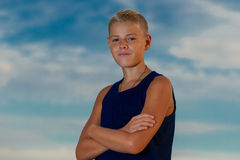 Young handsome teenager on the beach. The sky in the background. Royalty Free Stock Images