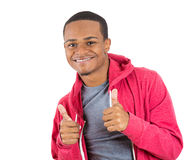 Young handsome teenager giving two thumbs up at the camera Stock Photos