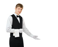 Young handsome waiter gesturing welcome. Portrait of young handsome waiter gesturing welcome isolated on white background with copy space Royalty Free Stock Photos