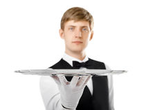 Young handsome waiter holding empty tray Stock Photos