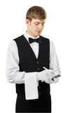 Young handsome waiter taking order. And making note isolated on white background Royalty Free Stock Image