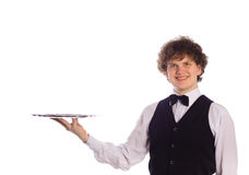 Young handsome waiter with tray. Isolated on white Stock Image