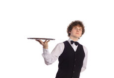 Young handsome waiter with tray. Isolated on white Royalty Free Stock Photo
