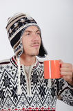 Young handsome winter man with cup of tea Stock Photography