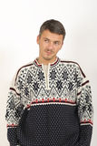 Young handsome winter man in knit clothes Royalty Free Stock Photography
