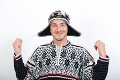 Young handsome winter man in knit clothes Royalty Free Stock Photos