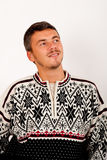 Young handsome winter man in knit sweater Stock Image