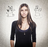 Young handsome woman with angel and devil Stock Photo