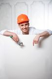 Young handsome worker behind blank board Royalty Free Stock Image