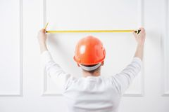 Young handsome worker in helmet with measuring Royalty Free Stock Images
