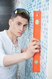Young handsome worker with spirit level Royalty Free Stock Photography