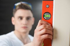 Young handsome worker with spirit level Stock Photo