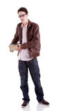 Young and handsome young man, with books Royalty Free Stock Image