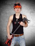 Young handyman with ax Royalty Free Stock Photos