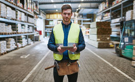 Young handyman or builder in a warehouse Royalty Free Stock Image