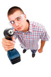 Young handyman drilling Stock Images