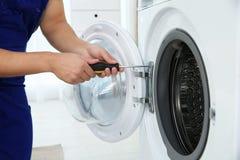 Free Young Handyman Fixing Washing Machine, Closeup. Stock Photography - 134343722
