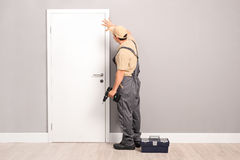 Young handyman installing a door Royalty Free Stock Image
