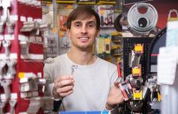 Young handyman making door keys copies Royalty Free Stock Photo