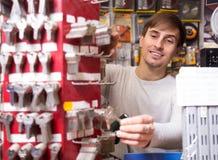 Young handyman offering door keys copies Royalty Free Stock Photography