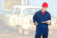 Mechanic reading manual Stock Photography